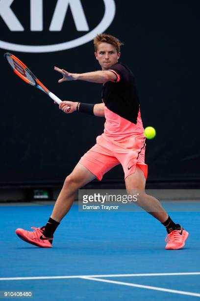 Aidan McHugh of Great Britain plays a forehand against Chun Hsin Tseng of Taipei in the boys' singles semifinal during the Australian Open 2018...