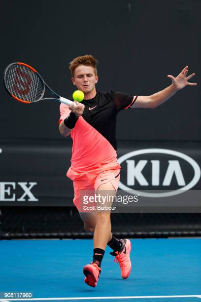 Aidan McHugh of Great Britain plays a forehand against Filip Cristian Jianu of Romania during the Australian Open 2018 Junior Championships at...