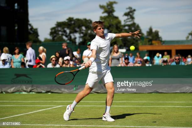 Aidan McHugh of Great Britain plays a forehand during the Boy's Singles first round match against Gianni Ross of the United States on day six of the...
