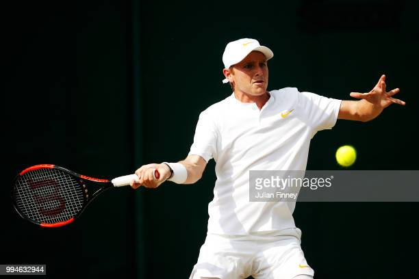 Aidan McHugh of Great Britain plays a forehand in his Boys' Singles first round match on day seven of the Wimbledon Lawn Tennis Championships at All...
