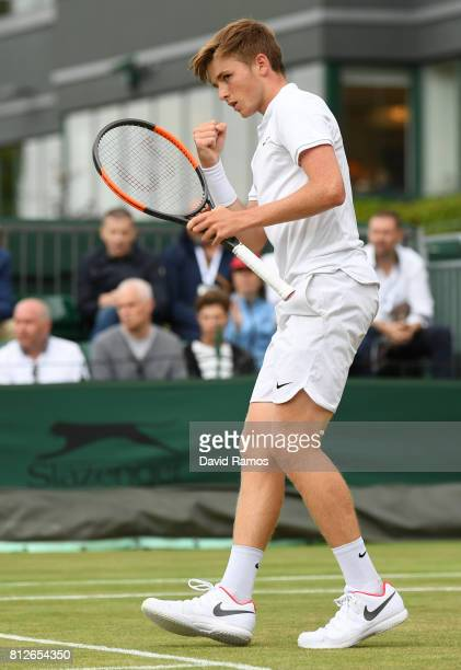 Aidan McHugh of Great Britain reacts during the Boy's Singles second round match against Marko Miladinovic of Serbia on day eight of the Wimbledon...