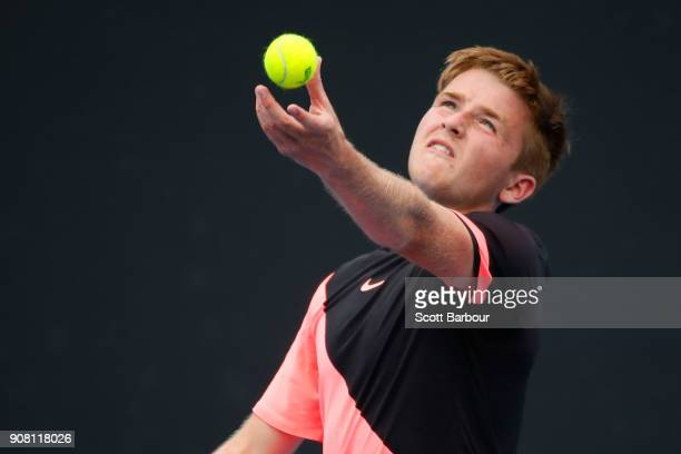 Aidan McHugh of Great Britain serves against Filip Cristian Jianu of Romania during the Australian Open 2018 Junior Championships at Melbourne Park...