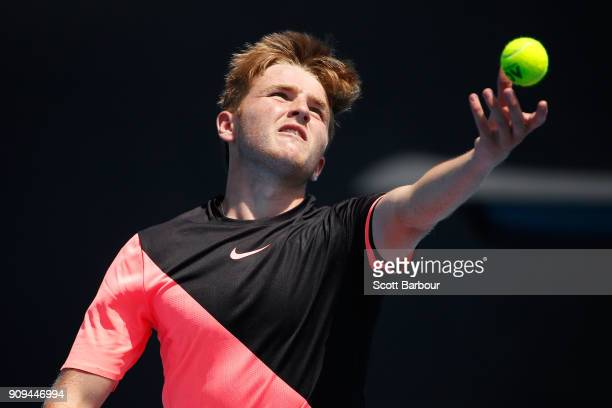 Aidan McHugh of Great Britain serves in his third round match against Ondrej Styler of the Czech Republic during the Australian Open 2018 Junior...