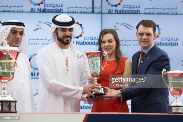 Aidan O'Brien receives the trophy after Mendelssohn winning the UAE Derby during the Dubai World Cup Day at Meydan Racecourse on March 31 2018 in...