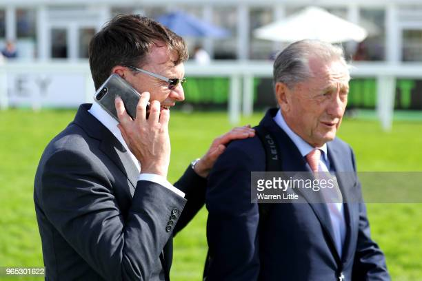 Aidan O'Brien trainer of Forever Together and part owner Derrick Smith celebrate winning the Investec Oaks during Ladies Day of the Investec Derby...