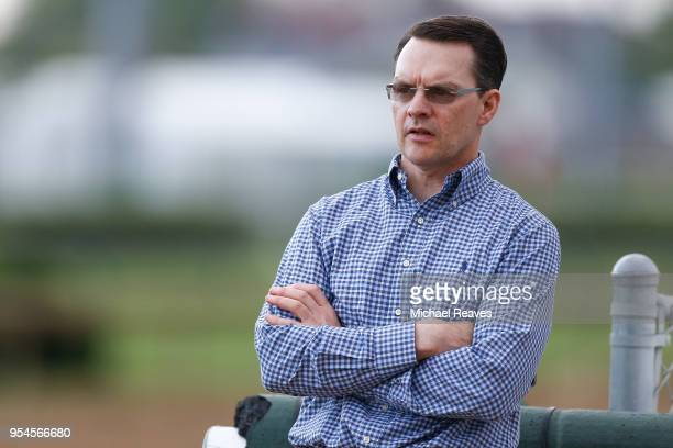 Aidan O'Brien trainer of Mendelssohn looks on during morning workouts in preparation for the Kentucky Derby at Churchill Downs on May 4 2018 in...