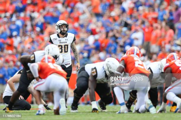 Aidan O'Neill of the Towson Tigers prepares to kick a field goal during the second quarter of a game against the Florida Gators at Ben Hill Griffin...