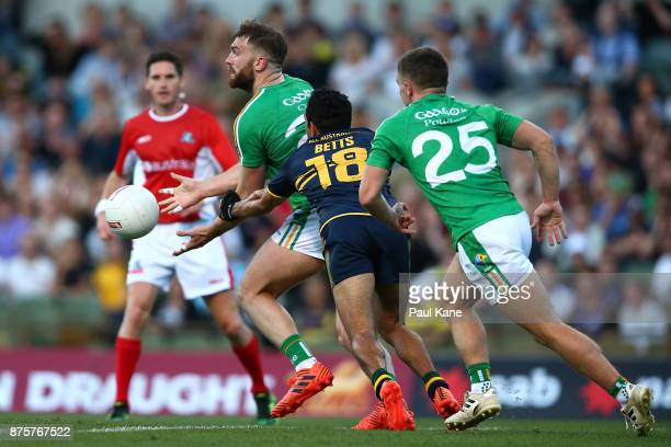 Aidan O'Shea of Ireland gets his hand pass away while being tackled by Eddie Betts of Australia during game two of the International Rules Series...