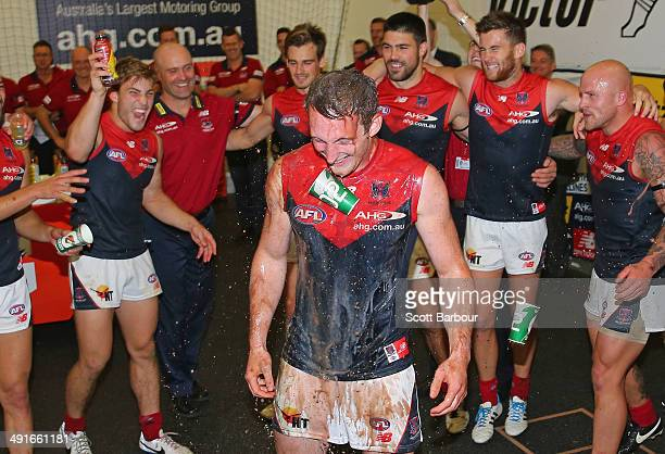 Aidan Riley and the Demons celebrate in the changing rooms after winning the round nine AFL match between the Richmond Tigers and the Melbourne...