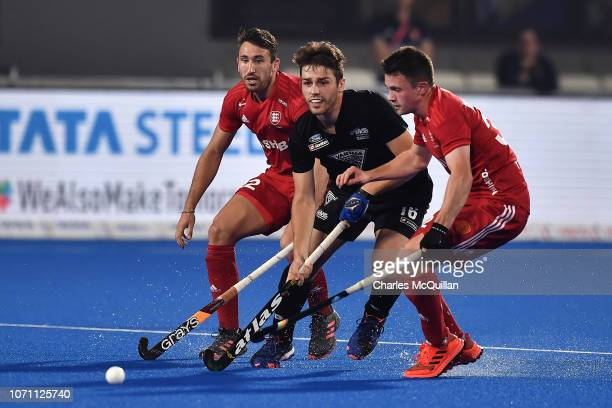 Aidan Sarikaya of New Zealand looks to hold off the England defence during the FIH Men's Hockey World Cup Crossover match between England and New...