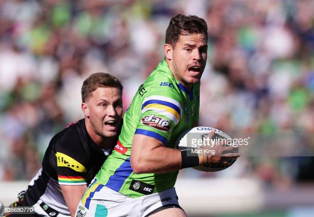Aidan Sezer of the Raiders gets away from Matt Moylan of the Panthers during the round 24 NRL match between the Canberra Raiders and the Penrith...
