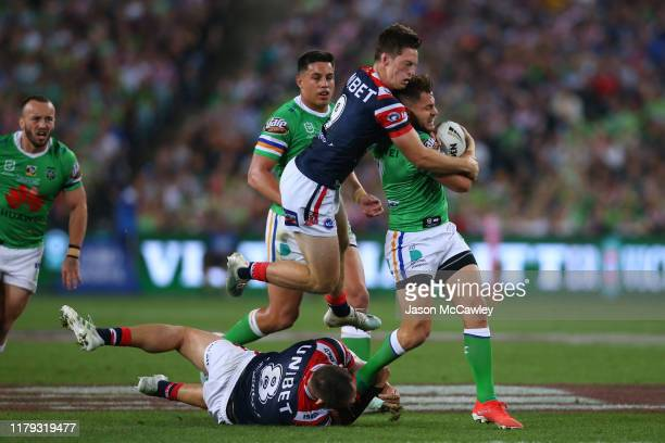 Aidan Sezer of the Raiders is tackled by Sam Verrills of the Roosters and Jared Waerea-Hargreaves of the Roosters during the 2019 NRL Grand Final...