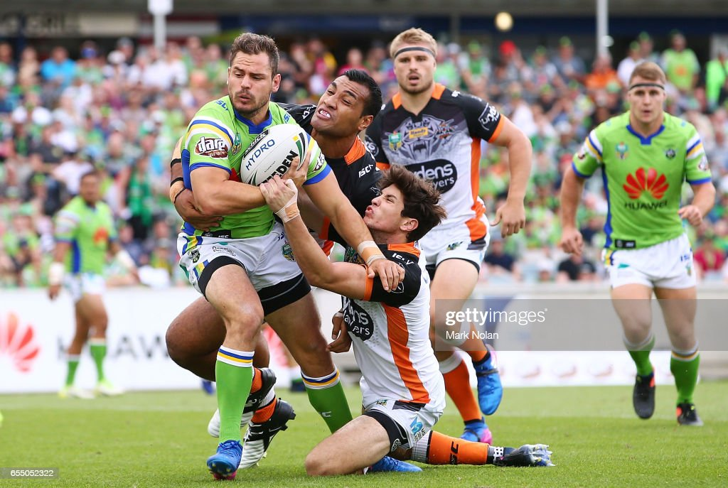 Aidan Sezer of the Raiders is tackled during the round three NRL match between the Canberra Raiders and the Wests Tigers at GIO Stadium on March 19, 2017 in Canberra, Australia.