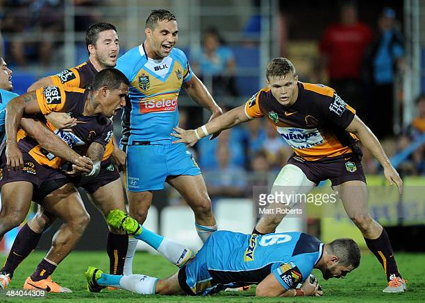 Aidan Sezer of the Titans scores a try during the round 6 NRL match between the Gold Coast Titans and the Brisbane Broncos at Cbus Super Stadium on...