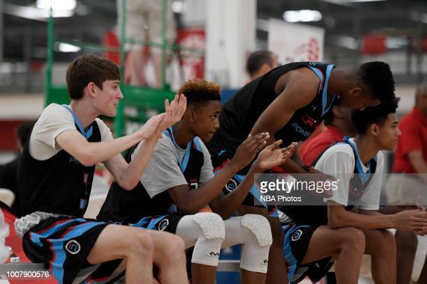 Aidan Shaw of Drive5 Power Elite Power Elite 2022 claps from the bench against Give Sports 2022 during the Junior NBA World Championship Central...
