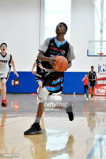 Aidan Shaw of Drive5 Power Elite Power Elite 2022 drives to the basket against Give Sports 2022 during the Junior NBA World Championship Central...