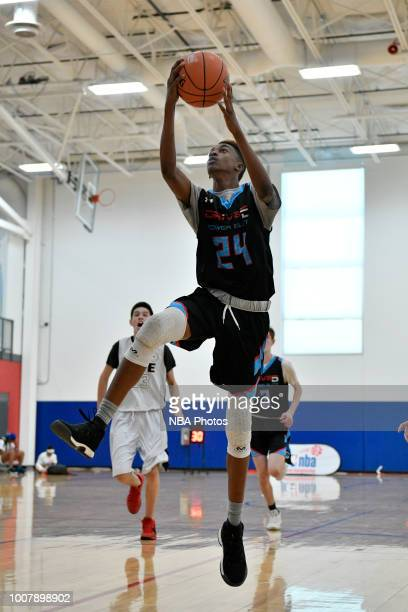 Aidan Shaw of Drive5 Power Elite Power Elite 2022 goes up to dunk the ball against Give Sports 2022 during the Junior NBA World Championship Central...