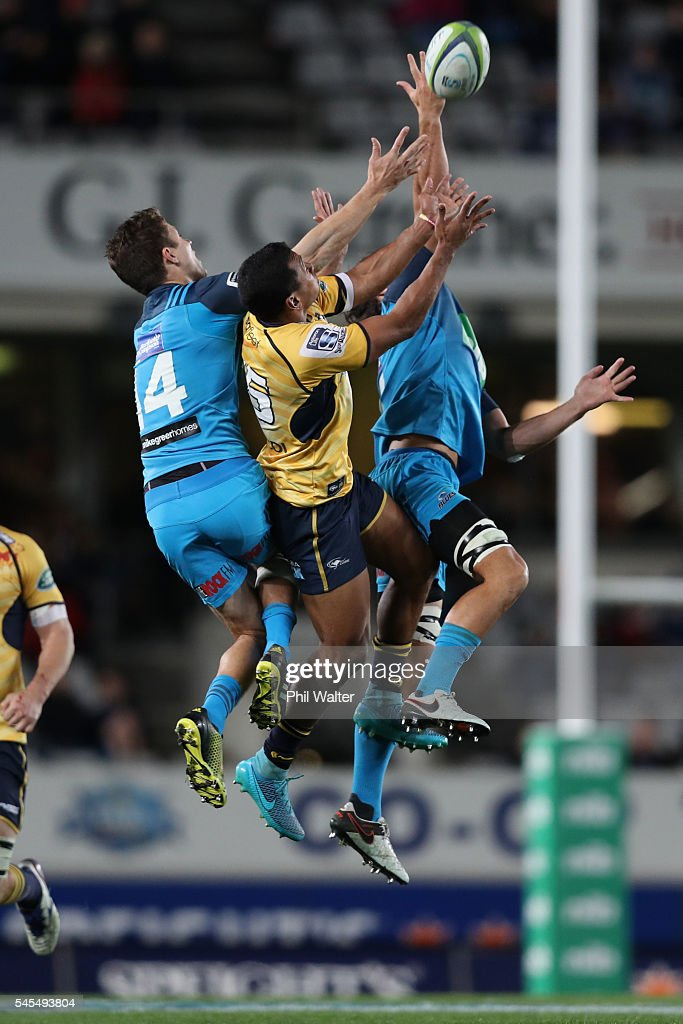 Aidan Toua of the Brumbies (C) and Matt Duffie of the Blues contest the high ball during the round 16 Super Rugby match between the Blues and the Brumbies at Eden Park on July 8, 2016 in Auckland, New Zealand.