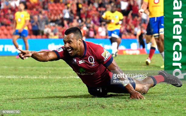 Aidan Toua of the Reds celebrates scoring a try during the round four Super Rugby match between the Reds and the Bulls at Suncorp Stadium on March 10...