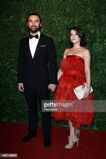Aidan Turner and guest attends the 60th London Evening Standard Theatre Awards at London Palladium on November 30 2014 in London England