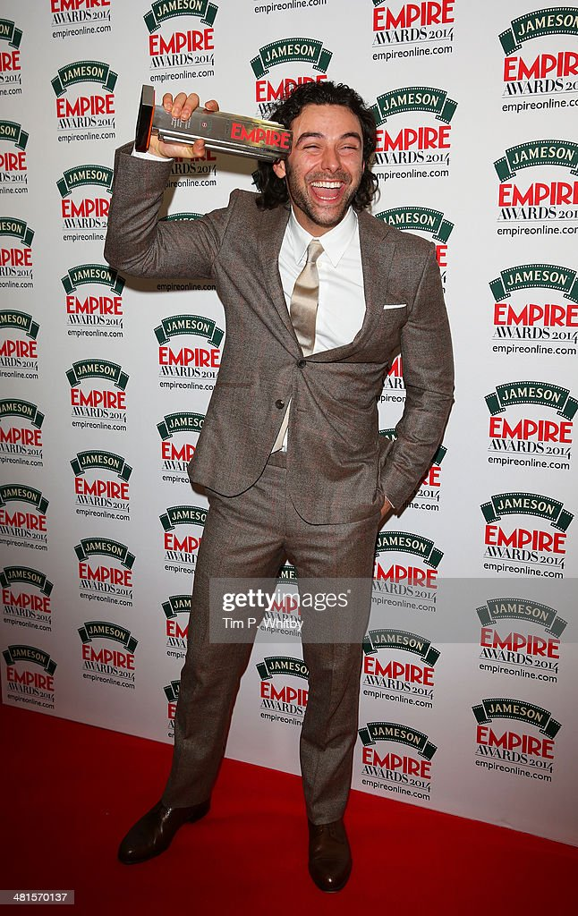 Aidan Turner, winner of the Best Male Newcomer award for 'The Hobbit: The Desolation Of Smaug' poses during the Jameson Empire Awards 2014 at the Grosvenor House Hotel on March 30, 2014 in London, England. Regarded as a relaxed end to the awards show season, the Jameson Empire Awards celebrate the film industry's success stories of the year with winners being voted for entirely by members of the public. Visit empireonline.com/awards2014 for more information.