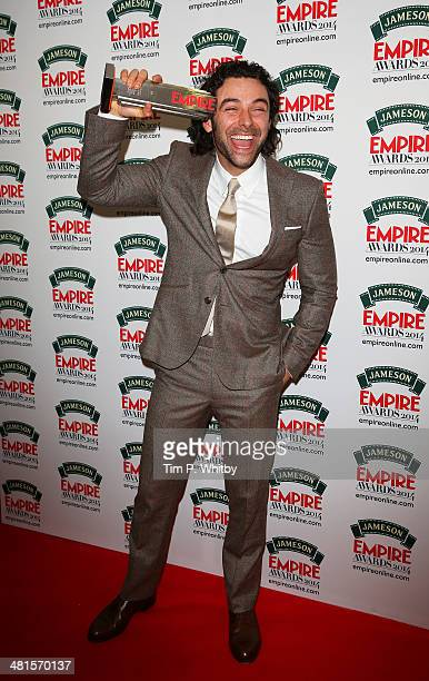 Aidan Turner winner of the Best Male Newcomer award for 'The Hobbit The Desolation Of Smaug' poses during the Jameson Empire Awards 2014 at the...