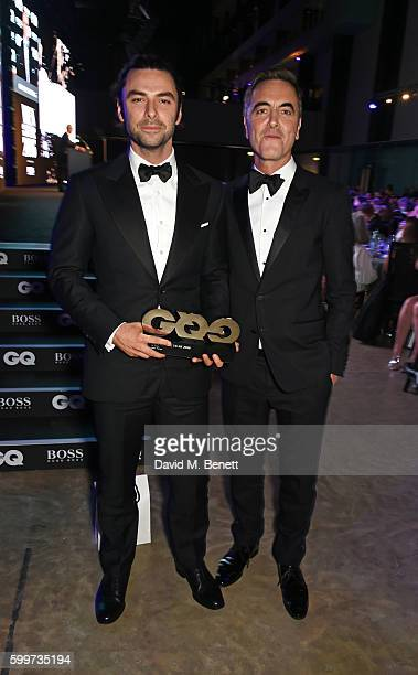Aidan Turner winner of the Television Actor award and James Nesbitt attend the GQ Men Of The Year Awards 2016 at the Tate Modern on September 6 2016...