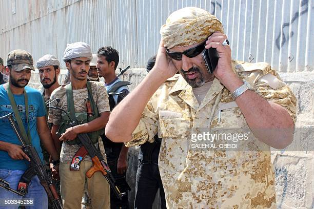 Aidarus alZubaidi the governor of the Yemeni port city of Aden speaks on the phone during a visit at Aden's port after it was completly secured by...