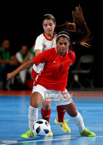 Aide Mendiola of Bolivia challenges Antonia Martinez of Spain in the Women's Futsal 3rd Place match between Bolivia and Spain during the Buenos Aires...