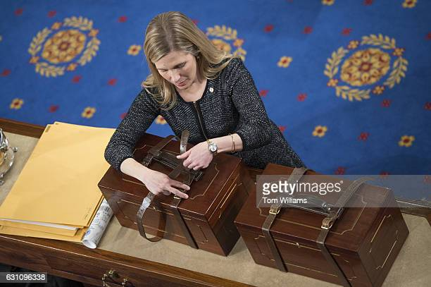 A aide opens Electoral College ballot boxes during a joint session of Congress to tally ballots for the president and vice president of the United...