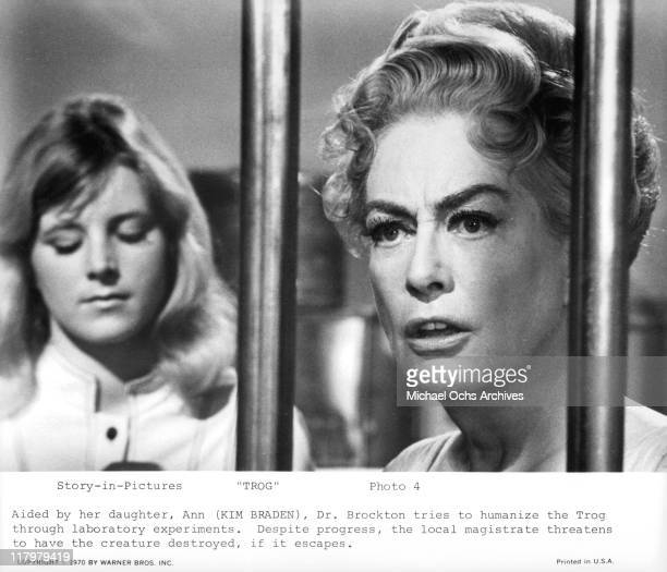Aided by her daughter Kim Braden Joan Crawford humanize the Trog through laboratory experiments in a scene from the film 'Trog' 1970