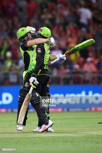 Aiden Blizzard and Arjun Nair of the Thunder celebrate victory during the Big Bash League match between the Sydney Thunder and the Sydney Sixers at...