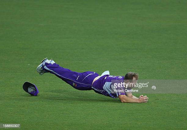 Aiden Blizzard of the Hurricanes fails to hold onto a catch from Simon Katich of the Scorchers during the Big Bash League match between the Hobart...