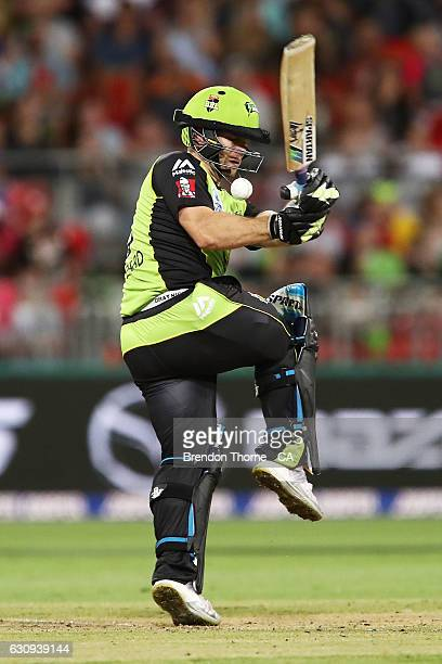 Aiden Blizzard of the Thunder attempts to play a hook shot during the Big Bash League match between the Sydney Thunder and Melbourne Stars at...