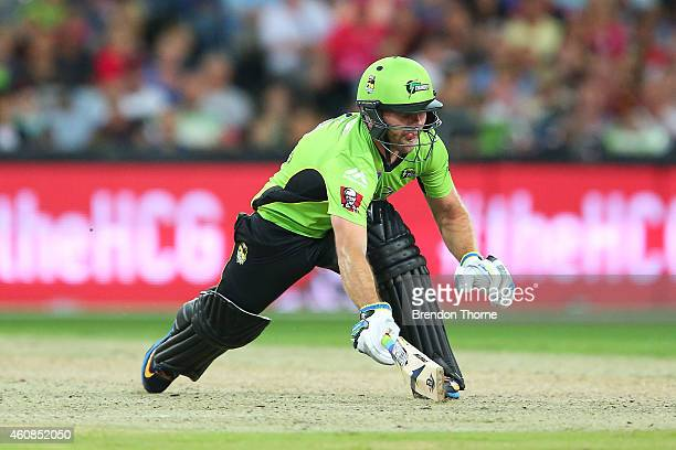 Aiden Blizzard of the Thunder dives for his crease during the Big Bash League match between the Sydney Thunder and the Sydney Sixers at ANZ Stadium...