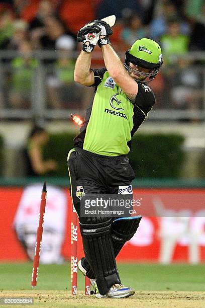 Aiden Blizzard of the Thunder is bowled out by Ben Hilfenhaus of the Stars during the Big Bash League match between the Sydney Thunder and Melbourne...