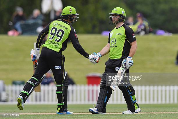 Aiden Blizzard of the Thunder is coongratulated by Ben Rohrer of the Thunder after scoring his half century during the T20 practice match between...
