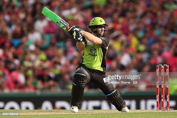 Aiden Blizzard of the Thunder plays a cover drive during the Big Bash League match between the Sydney Sixers and the Sydney Thunder at Sydney Cricket...