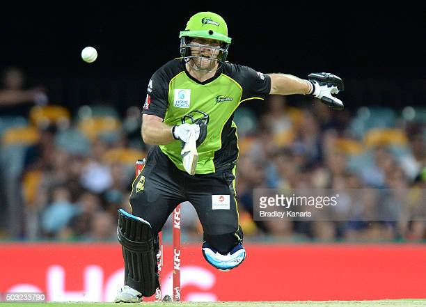 Aiden Blizzard of the Thunder takes a run during the Big Bash League match between the Brisbane Heat and the Sydney Thunder at The Gabba on January 3...