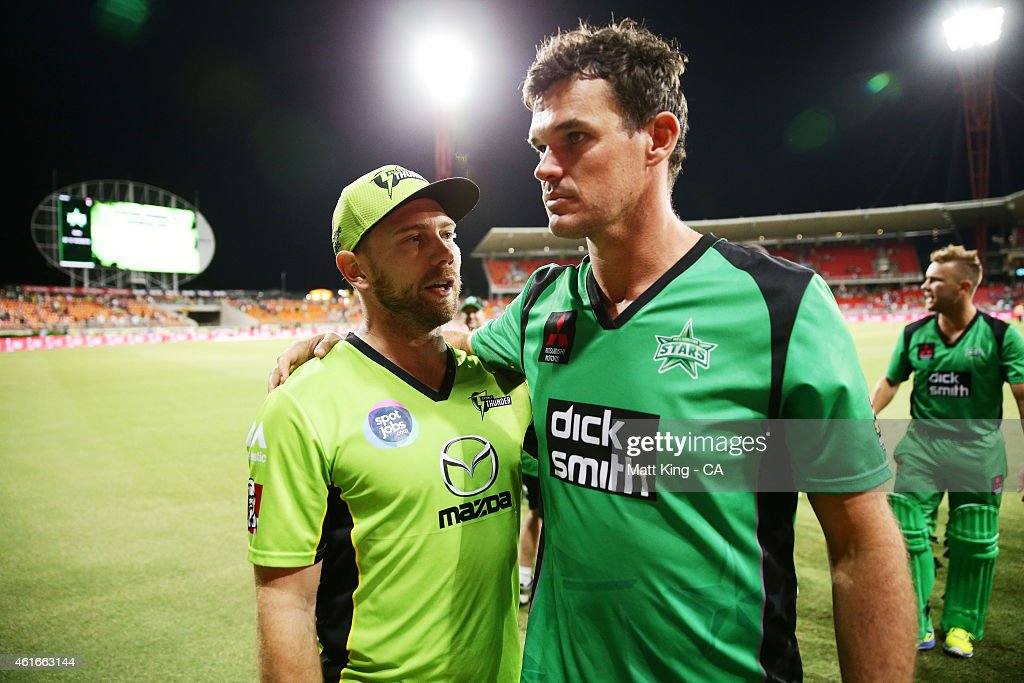 Aiden Blizzard of the Thunder (L) talks to Clint McKay of the Stars (R) after the Big Bash League match between the Sydney Thunder and the Melbourne Stars at Spotless Stadium on January 17, 2015 in Sydney, Australia.