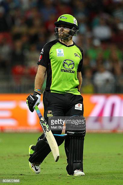 Aiden Blizzard of the Thunder walks off the field after being dissmissed by Jason Behrendorff of the Scorchers during the Big Bash League match...