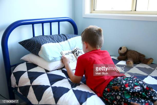 Aiden Blyth son of photographer is seen laying on his bed reading a book during home schooling on March 31 2020 in Sydney Australia Around the globe...