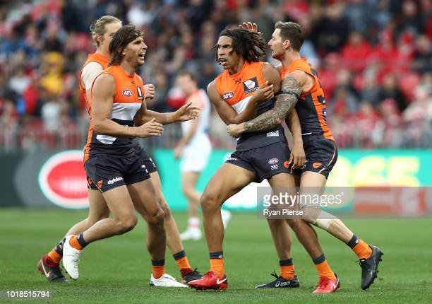 Aiden Bonar of the Giants celebrates a goal during the round 22 AFL match between the Greater Western Sydney Giants and the Sydney Swans at Spotless...