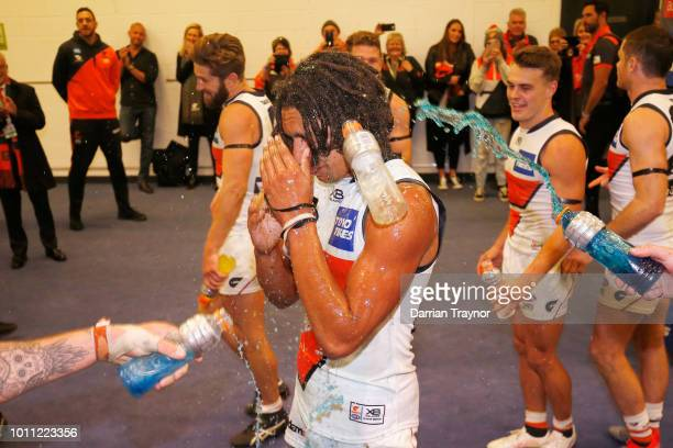 Aiden Bonar of the Giants is showered in gatorade by team mates after the round 20 AFL match between the Carlton Blues and the Greater Western Sydney...