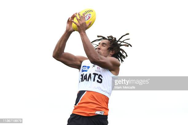 Aiden Bonar of the Giants takes a mark during the Greater Western Sydney Giants training session at Sydney Olympic Park Sports Centre on March 19...