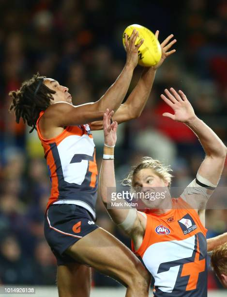 Aiden Bonar of the Giants takes a mark during the round 21 AFL match between the Greater Western Giants and the Adelaide Crows at UNSW Canberra Oval...