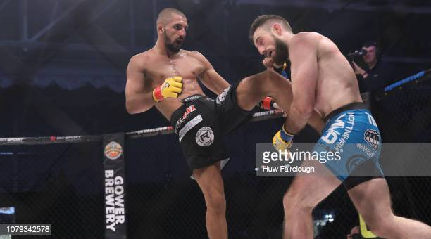 Aiden Lee Black Shortsvs Dean Trueman battle it out in their Featherweight Title Fight In Cage Warriors 100 on December 8 2018 at the Viola Arena in...