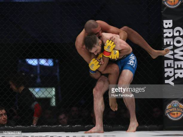 Aiden Lee Black Shortsvs Dean Trueman Featherweight Title Fight both battle it out In Cage Warriors 100 on December 8 2018 at the Viola Arena in...