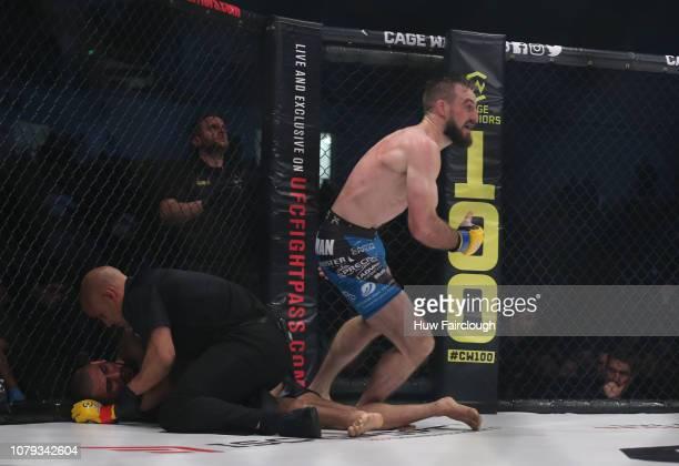 Aiden Lee Black Shortsvs Dean Trueman Featherweight Title Fight In Cage Warriors 100 Dean Trueman Celebrates after winning the bout by TKO on...