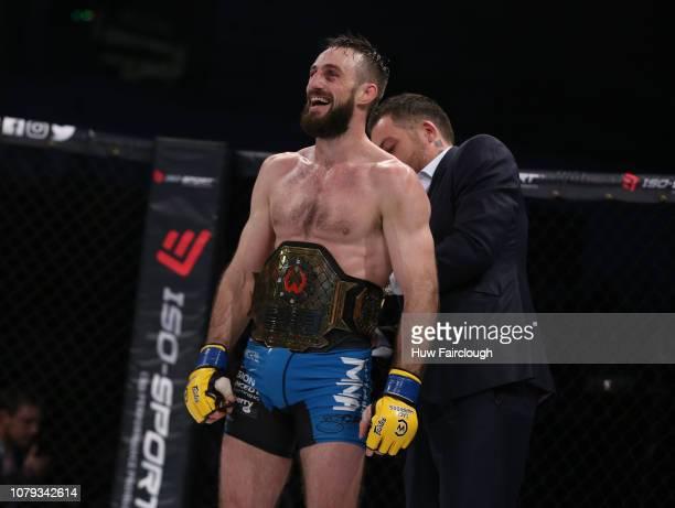 Aiden Lee Black Shortsvs Dean Trueman Featherweight Title Fight In Cage Warriors 100 Dean Trueman being awarded the title belt after winning the...